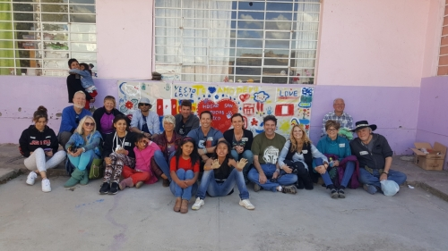 Group Photo with the mural